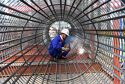 April 17, 2018  - Zhengzhou, China - A worker welds on the Zhengzhou Yellow River bridge under construction on the Zhengzhou-Jinan high-speed railway. The bridge is expected to be completed in April of 2020. (Credit Image: © Zhu Xiang/Xinhua via ZUMA Wire)