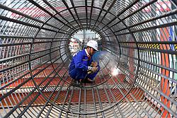 April 17, 2018  - Zhengzhou, China - A worker welds on the Zhengzhou Yellow River bridge under construction on the Zhengzhou-Jinan high-speed railway. The bridge is expected to be completed in April of 2020. (Credit Image: © Zhu Xiang/Xinhua via ZUMA Wire)