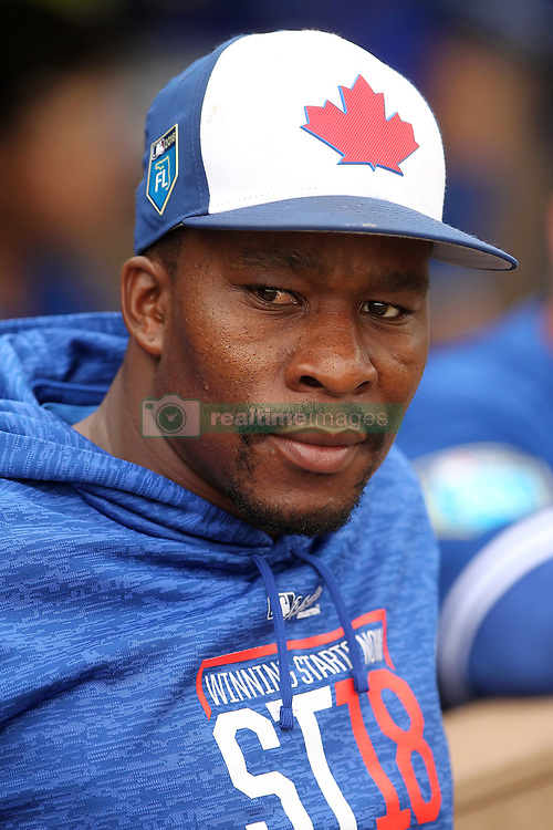 March 20, 2018 - Clearwater, FL, U.S. - CLEARWATER, FL - MARCH 20: Gift Ngoepe (61) of the Blue Jays watches the action on the field during the spring training game between the Toronto Blue Jays and the Philadelphia Phillies on March 20, 2018, at Spectrum Field in Clearwater, FL. (Photo by Cliff Welch/Icon Sportswire) (Credit Image: © Cliff Welch/Icon SMI via ZUMA Press)