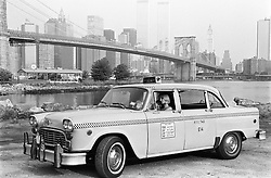 Couple resting in a old fashioned checker cab in New York City
