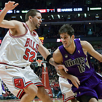21 December 2009: Sacramento Kings forward Omri Casspi drives past Chicago Bulls center Brad Miller during the Sacramento Kings 102-98 victory over the Chicago Bulls at the United Center, in Chicago, Illinois, USA.