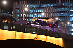 A helicopter lands on London Bridge as police are responding to three incidents in the capital, amid reports that a vehicle collided with pedestrians on London Bridge, Scotland Yard said. Officers are dealing with reports of stabbings in Borough Market, where armed officers attended and shots were fired. They are also at an incident in the Vauxhall area.