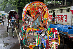 June 17, 2017 - Dhaka, Dhaka, Bangladesh - June 16, 2017 Dhaka, Bangladesh - Rickshaw pullers take rest in the side of the road heavy rainfall made in Dhaka city. The death toll rises to 156 in several hill districts including Banderban, Chittagong and Rangamati after the landslides following heavy rainstorm in those areas. (Credit Image: © K M Asad via ZUMA Wire)