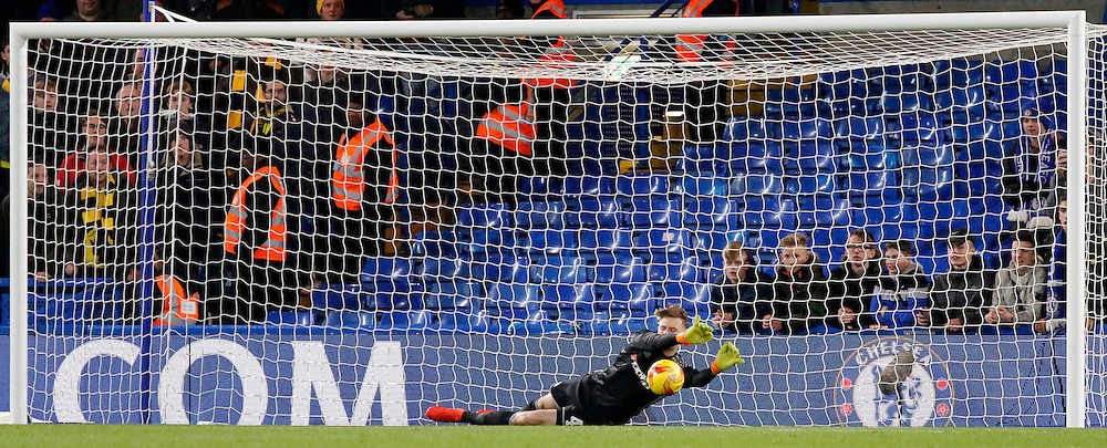 Chelsea's Bradley Collins saves the spot kick from Oxford's Aaron Martin during the Checkatrade Trophy match between Chelsea U21's and Oxford United at Stamford Bridge in London. November 8, 2016.<br /> Carlton Myrie / Telephoto Images<br /> +44 7967 642437