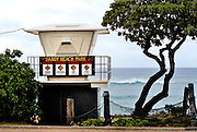 Surf patrol lookout tower with several warning signs for surfers and swimmers. Honolulu, Hawaii RIGHTS MANAGED LICENSE AVAILABLE FROM www.gettyimages.com -- contact Sheldon for details