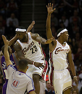 MORNING JOURNAL/DAVID RICHARD.Cleveland's LeBron James, center, and Daniel Gibson, right, try to block a 3-point shot by Leandro Barbosa of Phoenix.