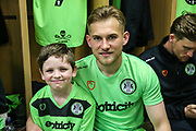 Forest Green Rovers George Williams(11) with matchday mascot during the EFL Sky Bet League 2 match between Forest Green Rovers and Milton Keynes Dons at the New Lawn, Forest Green, United Kingdom on 30 March 2019.