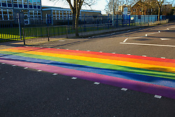 © Licensed to London News Pictures. 11/02/2020. London, UK. A LGBT rainbow-coloured crossing outside a school in north London in celebration of LGBT History Month. The school, which is the first one in England to have a rainbow coloured crossing outside a school, claims that it has received around 200 abusive messages on social media. Photo credit: Dinendra Haria/LNP