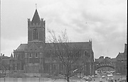 Christchurch Cathedral Dublin..1971..16.04.1971..04.16.1971..16th April 1971..Christ Church Cathedral (or, more formally, The Cathedral of the Holy Trinity) is the cathedral of the United Dioceses of Dublin and Glendalough and the cathedral of the Ecclesiastical province of the United Provinces of Dublin and Cashel in the Church of Ireland.It is situated in Dublin, Ireland and is the elder of the capital city's two medieval cathedrals, the other being St Patrick's Cathedral..It is reputed to have been the idea of King Sitric (Silkenbeard) to build the cathedral c1030. Around the 1180s the Normans rebuilt the old wooden structure in stone and is much as we see it today although some further additions have been added through the years that followed..Once surrounded by medieval streets and buildings, road building and construction now leaves the cathedral looking isolated on the high ground..It was built in a Gothic/Romanesque style and is known throught Europe as a major tourist attraction for visitors to Ireland. Ref; Wikipedia.