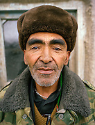 Niaz Ali, secretary of Abdul Rashid Khan, in the Pamir since 22 years. Doing thread with yak hair..Wakhis outside in Sarhad, the first village coming down from the Little Pamir. .Winter expedition through the Wakhan Corridor and into the Afghan Pamir mountains, to document the life of the Afghan Kyrgyz tribe. January/February 2008. Afghanistan