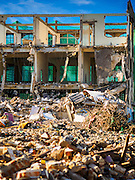 29 JUNE 2015 - BANGKOK, THAILAND:  Some of the old shophouses on Sukhumvit Soi 95 being torn down near the Bang Chak Market. The Bang Chak Market serves the community around Sois 91-97 on Sukhumvit Road in the Bangkok suburbs. About half of the market has been torn down, vendors in the remaining part of the market said they expect to be evicted by the end of the year. The old market, and many of the small working class shophouses and apartments near the market are being being torn down. People who live in the area said condominiums are being built on the land.    PHOTO BY JACK KURTZ