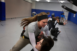 Brittany Cross and Stacey Berg, members of Hillary Clinton's security detail, take part in training drills at a training facility in Summit Point, W.Va on Dec. 16, 2011.