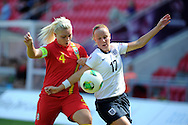 England's Bethany Mead ® is challenged by Lauren Price of Wales.  UEFA Womens U19 Championships 2013 match, Wales v England at Parc y Scarlets in Llanelli on Thursday 22nd August 2013. pic by Andrew Orchard ,Andrew Orchard sports photography,