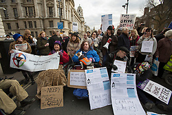 © licensed to London News Pictures. London, UK 16/02/2013. People blocking the road as they protesting against the high energy and fuel prices dictated by the six big energy companies in the UK, outside Department of Energy and Climate Change in Whitehall, London. Photo credit: Tolga Akmen/LNP