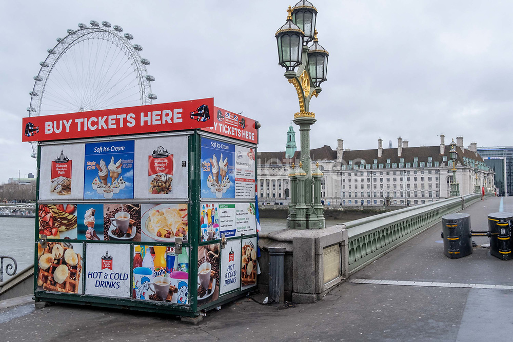 The day after the government introduced a third Coronavirus pandemic national lockdown, effectively a Tier 5 restriction, a locked up tourist trinket kiosk remains closed on Westminster Bridge as the capital experiences a grim post-Christmas and millions of Britons are told to stay at home, on 5th January 2021, in London, England.