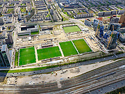 Nederland, Noord-Holland, Amsterdam; 17-04-2021; zicht op de Zuidas, met de velden van AFC (Amsterdamsche Football Club). Recht de Beethovenstraat met gebouw Valley (Winny Maas MVRDV) in aanbouw. Deelgebied Ravel.<br /> View of the Zuidas, with the soccer grounds of AFC (Amsterdam Football Club). Right the Beethovenstraat with the Valley building (Winny Maas MVRDV) under construction. Ravel sub-area.<br /> <br /> luchtfoto (toeslag op standaard tarieven);<br /> aerial photo (additional fee required)<br /> copyright © 2021 foto/photo Siebe Swart