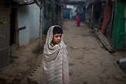 A child warms up during early morning hours in the Balukhali refugee camp in Cox's Bazar, Bangladesh.