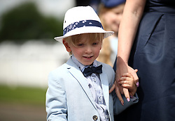 A young racegoer during ladies day of the 2018 Investec Derby Festival at Epsom Downs Racecourse, Epsom. PRESS ASSOCIATION Photo. Picture date: Friday June 1, 2018. See PA story RACING Epsom. Photo credit should read: John Walton/PA Wire. RESTRICTIONS: Editorial use only - any intended commercial use is subject to prior Epsom Downs Racecourse approval. No Private Sales.