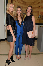 Left to right, sisters POPPY DELEVINGNE, CARA DELEVINGNE and CHLOE GRANT at a Dinner to celebrate the launch of the Mulberry Cara Delevingne Collection held at Claridge's, Brook Street, London on 16th February 2014.