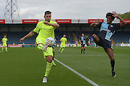 Billy Paynter, the Hartlepool United captain is challenged by Sido Jombati of Wycombe Wanderers (r). Skybet football league two match, Wycombe Wanderers v Hartlepool Utd at Adams Park in High Wycombe, Bucks on Saturday 5th Sept 2015.<br /> pic by John Patrick Fletcher, Andrew Orchard sports photography.