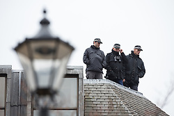 © Licensed to London News Pictures . 23/10/2015 . Manchester , UK . Armed police on the roof of Heron House opposite Manchester Town Hall waiting during the visit of Chinese president , Xi Jinping , to Manchester as part of his state visit to the United Kingdom . Photo credit: Joel Goodman/LNP