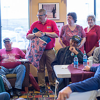 Navajo code talker Roy Hathorne surrounded by volunteers and veterans is presented with a Quilt of Valor during a veterans dinner at Comfort Suites in Gallup Thursday.