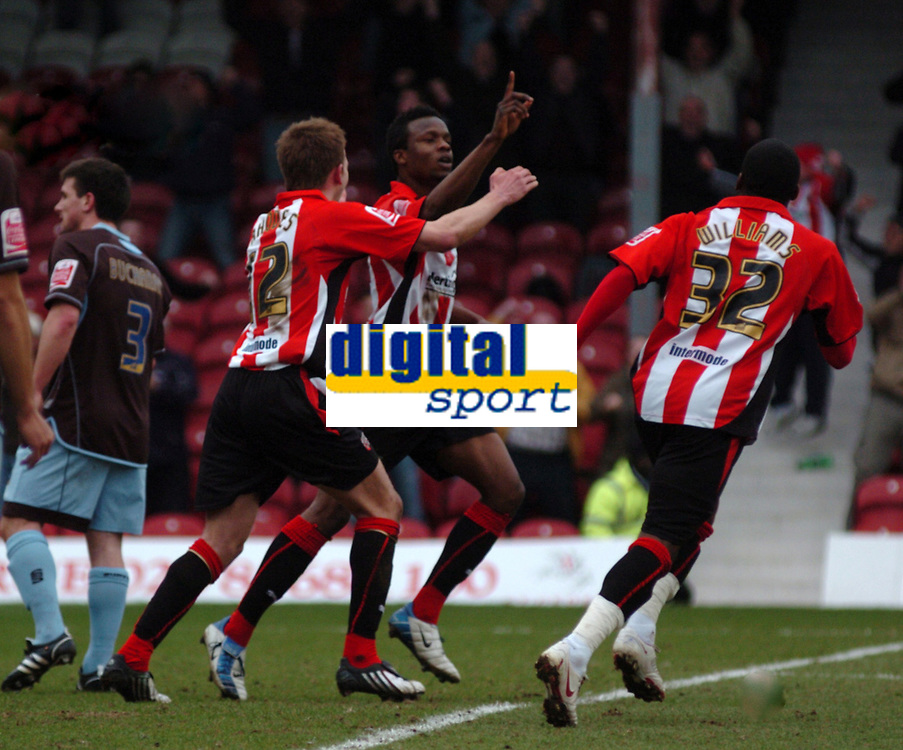 Photo: Tony Oudot/Richard Lane Photography. Brentford v Bury . Coca-Cola Football League Two. 28/02/2009. <br /> Marcus Bean of Brentford celebrates his goal with Jordan Rhodes and Marvin Williams after scoring the winning goal leaving Brentford clear at the top