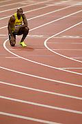 Mcc0041438 . Daily Telegraph..DT Sport..2012 Olympics..Asafa Powell crouches after fellow Jamaican Usain Bolt wins the 100 meter Mens Final ...5 August 2012....