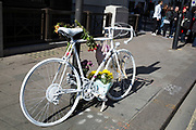 Ghost bike in central London. A ghost bike or ghostcycle is a bicycle set up as a roadside memorial in a place where a cyclist has been killed or severely injured. Apart from being a memorial, it is usually intended as a reminder to passing motorists to share the road. Ghost bikes are usually junk bicycles painted white, sometimes with a placard attached, and locked to a suitable object close to the scene of the accident. Many of these memorials are political statement.
