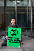 Climate change activists from the Extinction Rebellion group glued themselves to the entrance to the London Stock Exchange in the heart of the City of London financial district in protest that the government is not doing enough to avoid catastrophic climate change and to demand the government take radical action to save the planet, on 25th April 2019 in London, England, United Kingdom. Extinction Rebellion is a climate change group started in 2018 and has gained a huge following of people committed to peaceful protests.