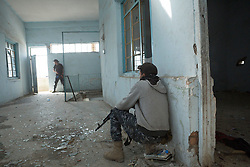 Licensed to London News Pictures. 01/04/2017. Mosul, Iraq. Iraqi Federal Police officers look for an ISIS sniper inside a West Mosul building today (01/04/2017). Iraqi forces continue to fight house to house as they push further into West Mosul. Iraqi forces are now advancing on the city's old districts where Islamic State fighters still hold out. Photo credit: Matt Cetti-Roberts/LNP