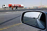 Dubai .Forigen workers on day off  crossing an 6 lane expressway  to go shopping or back to their dormitories.