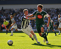 Photo: Tony Oudot/Richard Lane Photography. West Bromwich Albion v Plymouth Argyle. Coca Cola Championship. 12/09/2009. <br /> Kit change! Plymouth had to change from white to green during the game.<br /> Chris Clark of Plymouth with Chris Brunt of WBA