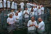 Israel, Yardenit Baptismal Site In the Jordan River Near the Sea of Galilee, A group of American pilgrims being Baptized