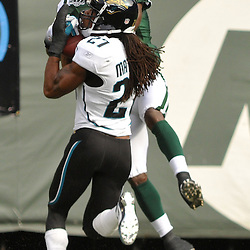 Nov 15, 2009; East Rutherford, NJ, USA; Jacksonville Jaguars cornerback Rashean Mathis (27) intercepts a pass inteded for New York Jets wide receiver Jerricho Cotchery (89) during first half NFL action between the New York Jets and Jacksonville Jaguars at Giants Stadium.