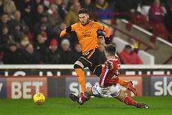 Wolverhampton Wanderers' Matt Doherty avoids a challenge from Barnsley's Gary Gardner during the Sky Bet Championship match at Oakwell, Barnsley.