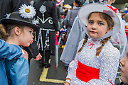Lily Stout aged 7 and friend - The London Borough of Havering enters a Mary Poppins themed group - The New Years day parade passes through central London form Piccadilly to Whitehall. London 01 Jan 2017