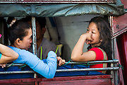 11 MAY 2013 - BANGKOK, THAILAND: People ride converted use as a bus in Bangkok.     PHOTO BY JACK KURTZ