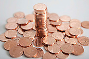 British one penny coins stacked up.