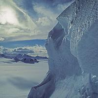 Icy seracs loom over the Calley Glacier on the Antarctic Peninsula, Antarctica.