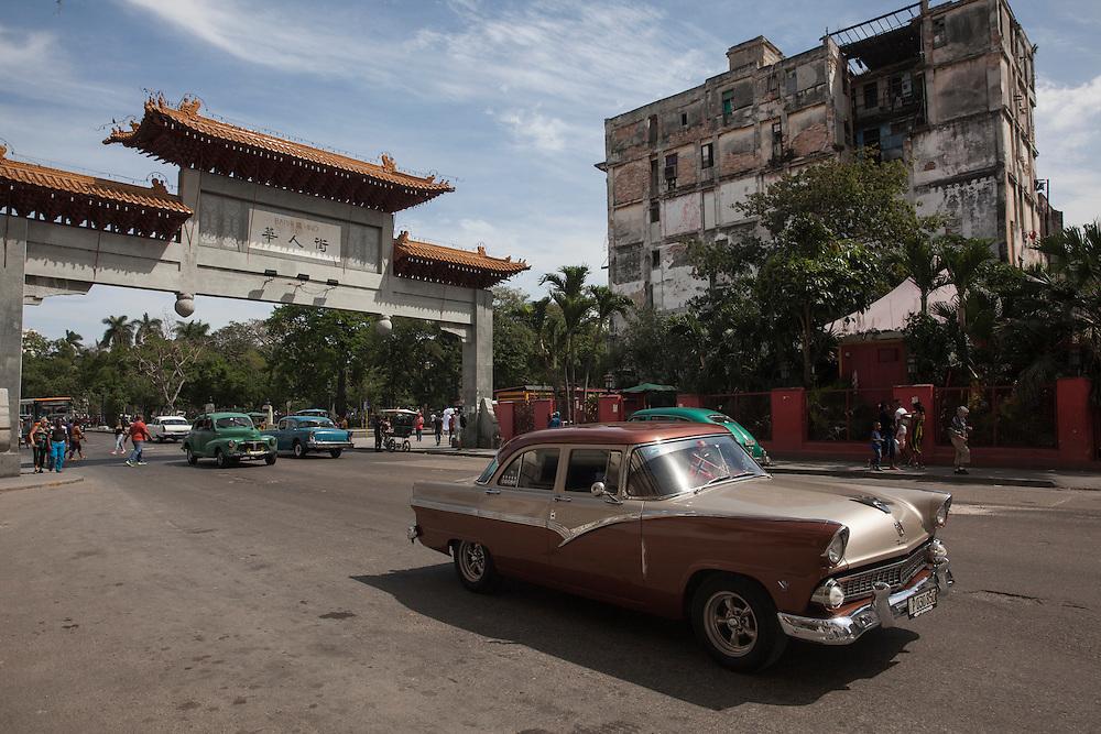 Old American car cruising through the chinese quarter in Havana, Cuba.