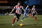 Lincoln City midfielder Lee Frecklington (19) on the ball during the EFL Sky Bet League 2 match between Lincoln City and Notts County at Sincil Bank, Lincoln, United Kingdom on 13 January 2018. Photo by Nigel Cole.