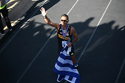 November 13, 2016 - Athens, Greece - Christoforos Merousis  waving to the stadium after finisthing the Marathon..50.000 long range runners take part in the 42 killometers long Athens Marathon the Authentic in Greece starting from the City of Marathona and ending at Kalimarmaro Stadium in Athens. (Credit Image: © George Panagakis/Pacific Press via ZUMA Wire)