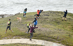 © Licensed to London News Pictures. 25/08/2020. City, UK. People are blown in the strong winds in Langland head, Gower, as Storm Francis brings poor weather conditions across the UK with high winds and heavy rain causing disruption. Photo credit: Robert Melen/LNP