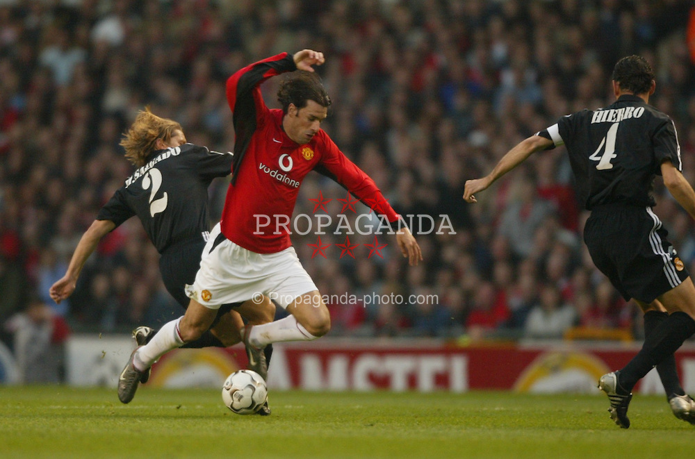 MANCHESTER, ENGLAND - Wednesday, April 23, 2003: Real Madrid's Michel Salgado tackles Manchester United's Ruud Van Nistelrooy during the UEFA Champions League Quarter Final 2nd Leg match at Old Trafford. (Pic by David Rawcliffe/Propaganda)