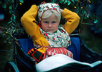 Young Swedish girl at the maypole raising during the Midsummer celebration, Siljansnas, Dalarna Province, Sweden