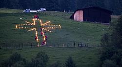 """THEMENBILD - am Sonnenwend-Wochenende wird in allen Teilen Tirols das Herz-Jesu Feuer entfacht. Die Feuer, die mit Fackeln an den Hängen der Berge gestaltet werden haben eine lange Tradition in Tirol und die Wurzeln dieses Brauchs gehen auf das 18. Jahrhundert zurück. Im Bild ein Feuer der Bergrettung Gerlos in Form eines Kreuzes //  on the solstice weekend, there is the """"Herz-Jesu"""" rite in all parts of tyrol. The fires, which are decorated with torches on the slopes of the mountains, have a long tradition and the roots of this custom date back to the 18th century. In the picture a fire of Gerlos's mountain rescue in the form of a cross, Gerlos, Austria on 2017/06/23. EXPA Pictures © 2017, PhotoCredit: EXPA/ Jakob Gruber"""