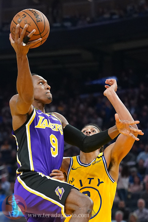 February 27, 2020; San Francisco, California, USA; Los Angeles Lakers guard Rajon Rondo (9) shoots the basketball against Golden State Warriors guard Jordan Poole (3) during the second quarter at Chase Center.