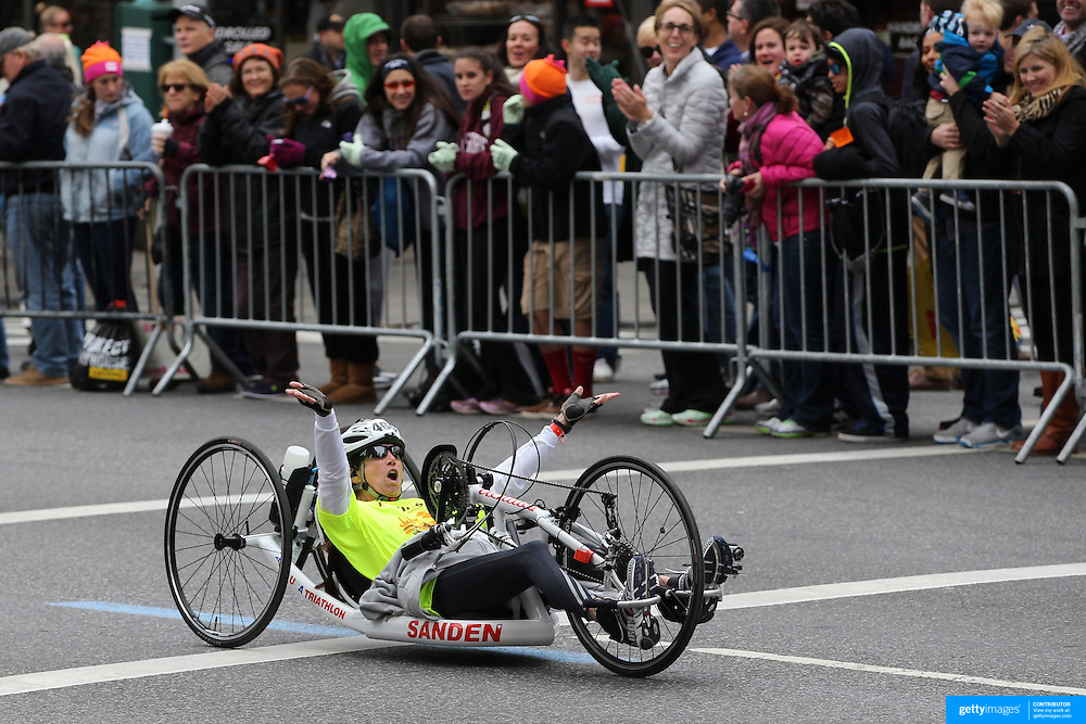 A wheelchair athlete in action along First Avenue in Manhattan, New York, during the ING New York Marathon. New York, USA. 3rd November 2013. Photo Tim Clayton
