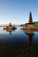 Pura Ulun Danu Bratan, or Pura Bratan is a major water temple in Bali, Indonesia.  (The other major water temple being Pura Ulun Danu Batur.)  The temple complex is located on the shores of Lake Bratan in the mountains near Bedugul.  One of the iconic images of Bali, the temple sits on the western shore of Lake Bratan and it gives the illusion of actually floating on the water though it is actually built on two tiny islands.  Built in 1633 the temple is devoted to Ida Batara Dewi Ulun Danu, goddess of the lake.